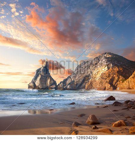 Beautiful sunrise over Rocky ocean beach, Wonderful world Landscape. Portugal, Europe