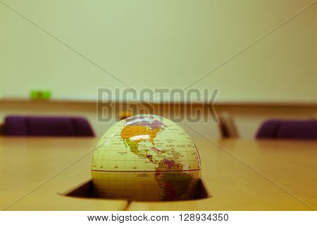 world globe sitting on a desk.vintage world globe.