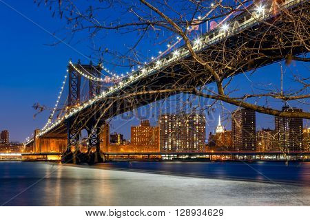 Famous Manhattan Bridge spanning the East River towards Manhattan in New York City, USA