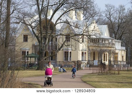 SAINT PETERSBURG, RUSSIA - APRIL 12, 2015: Walk near the Palace-Cottage, sunny april day. Park