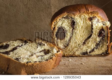 Romanian traditional sponge cake - Cozonac over wooden background
