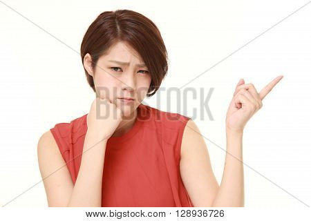 young Japanese woman doubting on white background