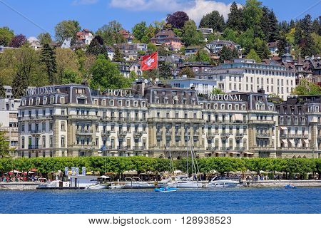 Lucerne, Switzerland - 8 May, 2016: Nationalquai quay, view over Lake Lucerne from the Bahnhofquai quay. Lucerne is a city in central Switzerland, it is the capital of the Swiss Canton of Lucerne and the capital of the district of the same name.