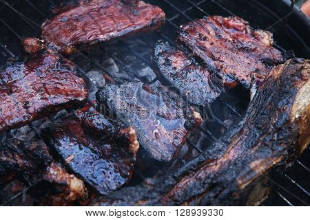 fresh red grilled beef meat fillet asado on deep round bbq grill over fire
