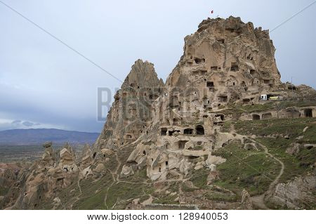 View of the mountain-fortress of Uchisar and the cave city. Cappadocia, Turkey