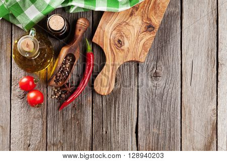 Spices and condiments on wooden table. Top view with copy space