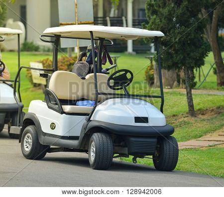 Golf carts on a golf course .