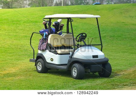 Golf carts on a green golf course