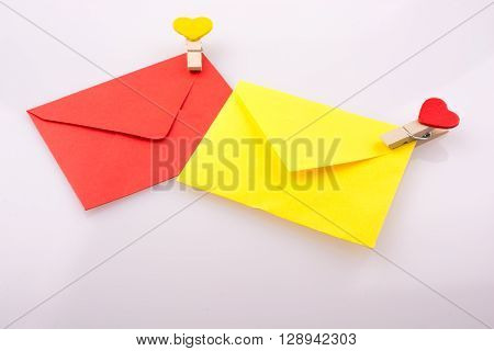 Red and yellow envelopes clipped with hearts