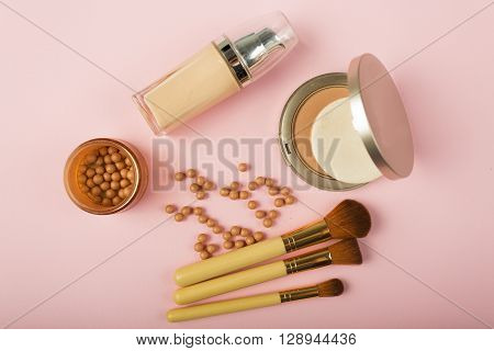Makeup Essentials On A Pink Background