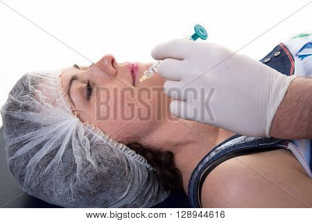 Woman Having Injection In Face As Beauty Treatment