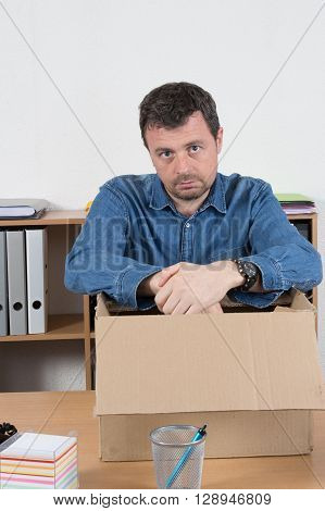 Portrait Of A Sad Businessman Carrying Box , Fired