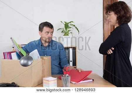 Sad man fired by a woman at office