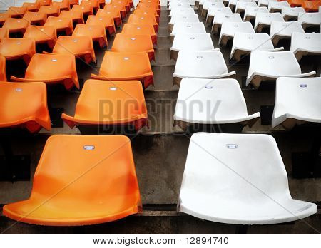 Orange and white seat in stadium