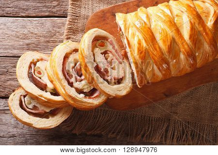 Venezuelan Bread Pan De Jamon Close-up On The Table. Horizontal Top View