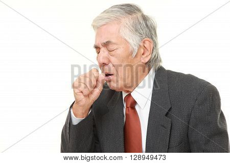 senior Japanese businessman coughing on white background
