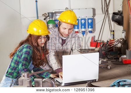 Couple Of Engineers Consult The Computer In A Steel Mill