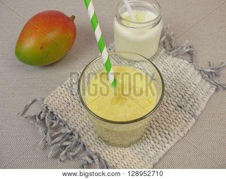Yogurt lassi with mango and fresh fruit