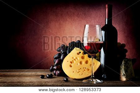 Cheese and grape to wine on vinous background
