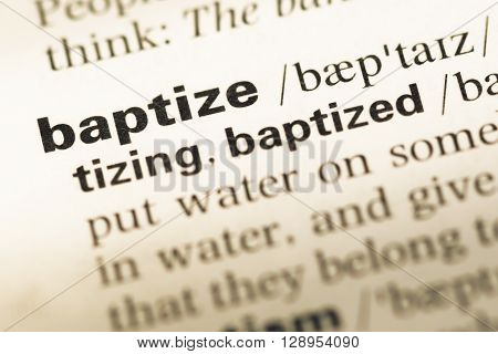 Close Up Of Old English Dictionary Page With Word Baptize.
