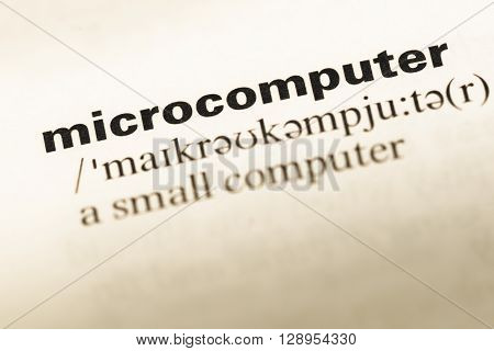 Close Up Of Old English Dictionary Page With Word Microcomputer.