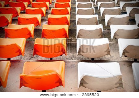 Orange and white seat in stadium