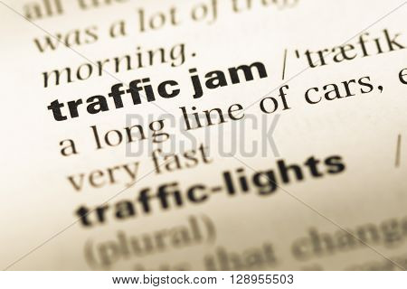 Close Up Of Old English Dictionary Page With Word Traffic Jam.