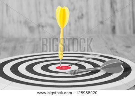 yellow Dart hit the center of dartboard