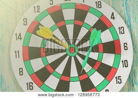 green and yellow  Dart hit the center of dartboard