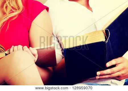Young couple reading a books together