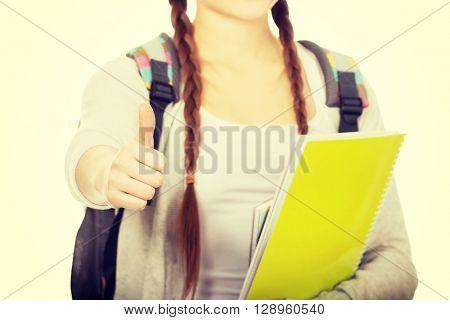 Teenager girl with school backpack.