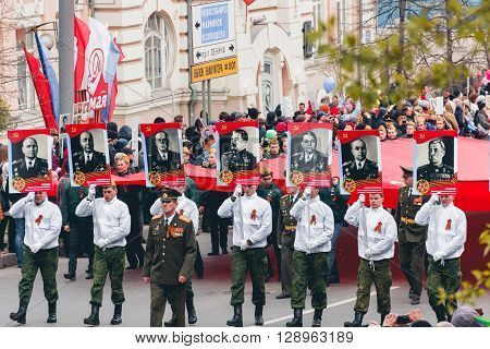TOMSK, RUSSIA - MAY 9, 2016:  Procession of people in Immortal Regiment on annual Victory Day, May, 9, 2016 in Tomsk, Russia