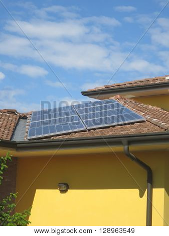 roof with photovoltaic panels towards the sun ** Note: Soft Focus at 100%, best at smaller sizes