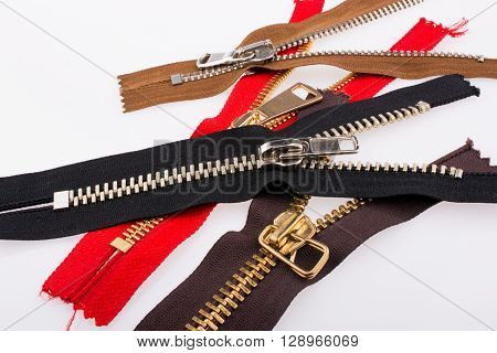 Color zippers scattered on a white background