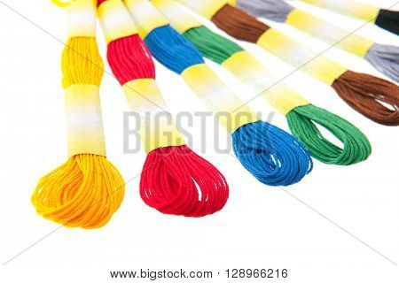 embroidery thread in colors isolated over white background