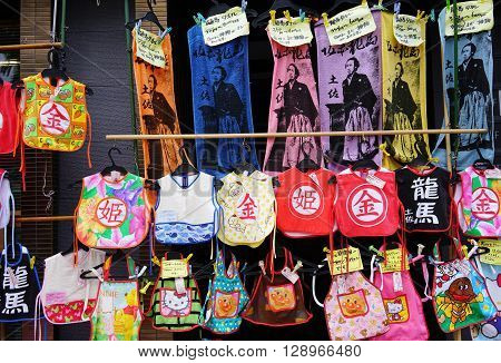 KOCHI, JAPAN- April 24: Daily Souvenir market on Kochi-Nichiyoichi (Otesuji-street), merchant display apron and towel for sale on April 24,2016, the Japan.