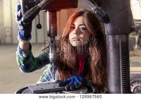 Portrait Of Pretty Girl At Work On Industrial Drilling Machine
