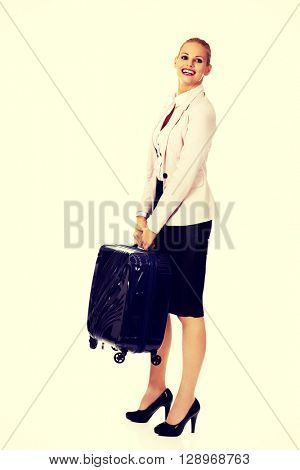 Smile business woman raising her suitcase