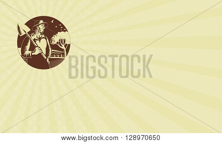 Business card showing illustration of an organic farmer holding shovel on shoulder looking to the side set inside circle with farm orchard in the background done in retro woodcut style.