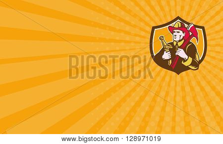 Business card showing illustration of a fireman fire fighter emergency worker looking to the side holding fire hose and fire axe set inside shield crest done in retro woodcut style.