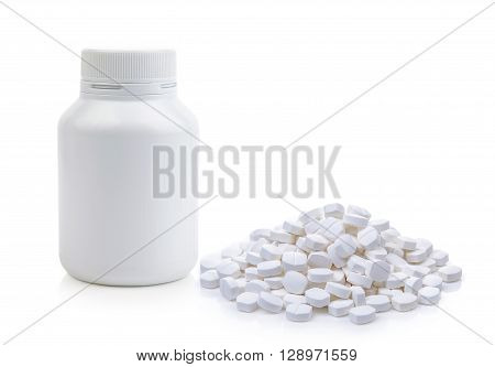 Pills spilling out of pill bottle isolated on a white background