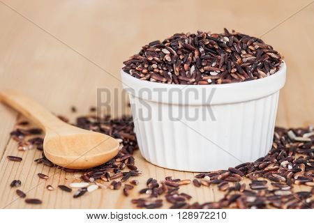 raw Rice berry on wood table background