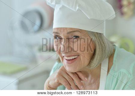 Portrait of a senior chef woman happy