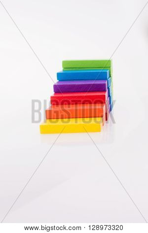 multi color domino placed on white background