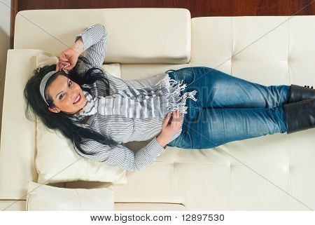 Top View Of Woman Relaxing In Sofa