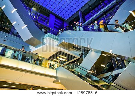 Hong Kong China - September 22 2007: People on the escalators of the Peack Tower resort and shops