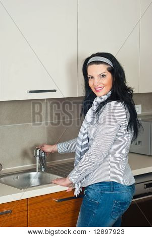Woman In Kitchen Open Faucet