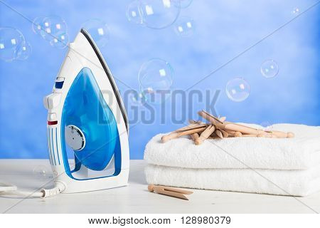 Freshly laundered towels with pegs and floating bubbles