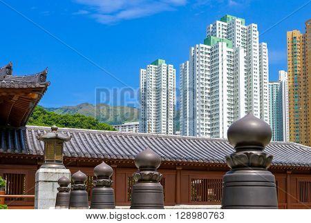 Hong Kong the Chi Lin antique monastry and in the background the towers of the new Kowloon quarter