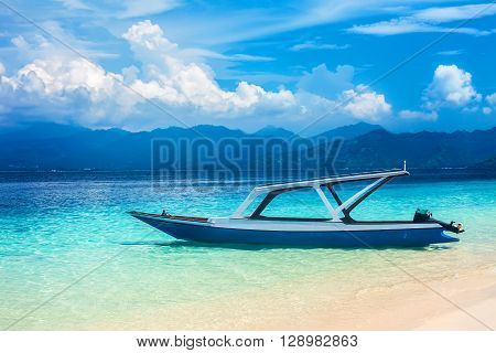boat on a beautiful tropical beach. vacation background